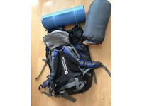 Mountain warehouse backpack with sleeping bag and mat