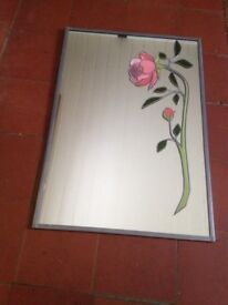 Beautiful mirror with pink stained glass rose.