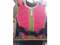 Children's horse riding accessories. Harry hall hat and body armor boots and Jodpers