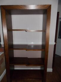 For Sale: Striking bookcase / shelf unit. Unusual design. Solid wood. Can deliver.