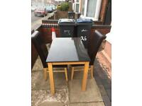 Lovely heavy granite dining Table with 2 chairs