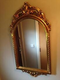 Ornate gold mounded mirror.