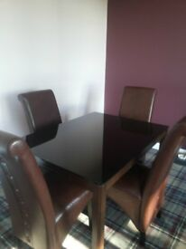 4 Seater Glass Top Dining Table with 4 High Back chairs, almost new