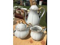 White china coffee set with gold edging