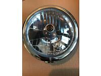 "Harley Davidson 5 3/4"" headlight including chrome surround trim, halogen bulb and sidelight bulb"