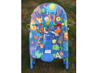 Baby chair, with play bar. Can rock. Excellent condition