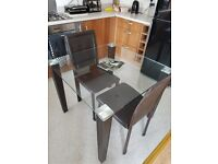 SMALL GLASS DINING TABLE AND TWO CHAIRS