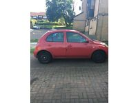 Red Nissan Micra 1.2 Automatic .