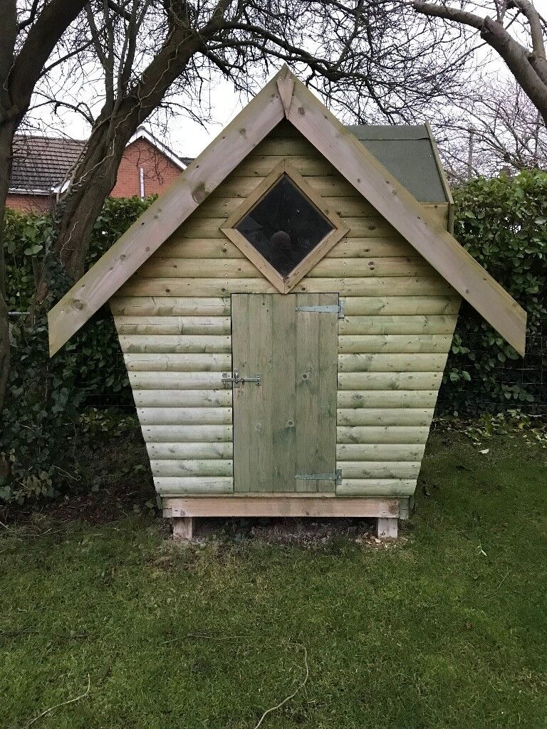 Playhouse 6' x 4' with dormer window plus wooden see-saw