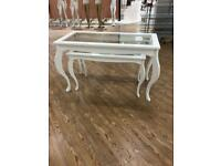 Two glass top tables