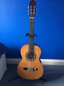 Child's 3/4 sized Valencia guitar, case and stand
