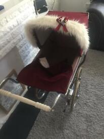 Child's silver cross pram
