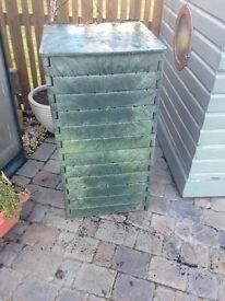 Dark green plastic compost bin. Folds flats so easy to transport