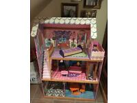 Large wooden dolls house in excellent condition
