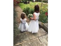 2 beautiful ivory bridesmaids dresses with grey sash and bow