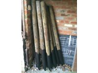 """Ten round pointed wooden fence posts 5.5ft high 4"""" width at top"""