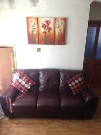 Brown leather style sofa for sale (price negotiable)