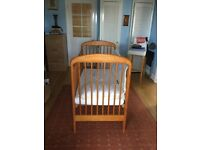 Wooden cot with new mattress and bedding