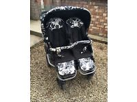 Free double pram suitable from birth. Comes with matching bag and foot moths and rain cover
