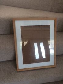 Wooden picture frame with cream mount