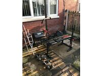 York weight bench with weights and bars