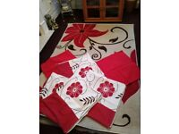 Red themed rug and cushion covers