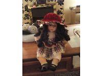Little Scottish girl porcelain and tartan doll