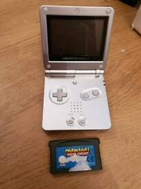 Silver gameboy sp and mario kart