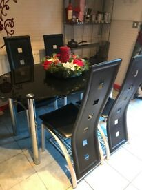Black Glass Dining Table and Chairs.