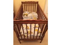 Child's cot complete with mattress and bedding