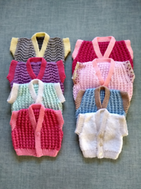 Hand knitted baby cardigans waistcoats hats and bootees