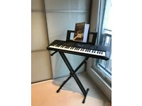 YAMAHA KEYBOARD WITH STAND AND INTRODUCTION TO KEYBOARD BOOK