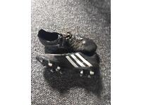 4 pairs of worn football boots