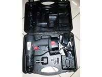 Cordless drill in box with charger and battery