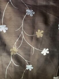 Brown curtains with cream floral design