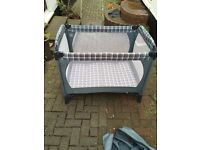Mothercare baby travel cot in good condition- barley used.