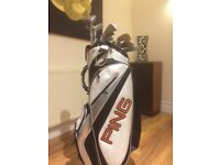 Golf clubs + ping bag