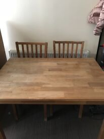 Wooden dining table and 4 wooden chairs with brown leather seats