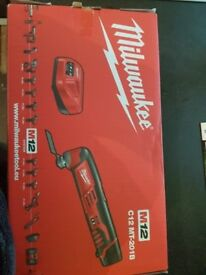 BRAND NEW MILWAUKEE multi-tool m12. 2x2amp batteries included with charger