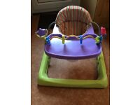 Baby walker, good condition, play toys attached.
