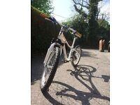 Boys white SPECIALIZED Hotrock mountain bike for sale.
