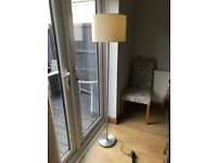 Free standing lamp with cream shade