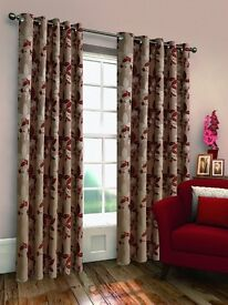 """A pair of 46"""" x 90"""" luxury lined eyelet curtains in a red leaf pattern"""