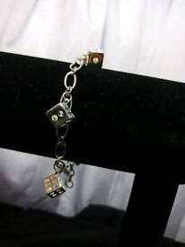 I have one 925 Sterling Silver bracelet with dise.