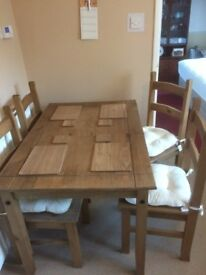 Rio dining table and four chairs.Good clean condition.