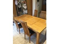 Solid oak extending table. Seats up to 10 people.