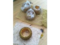 Brand new gold beaded napkin rings x 4 in gold glitter drawstring bag. £5. Can post or collect from