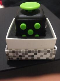 Green and black fidget cube