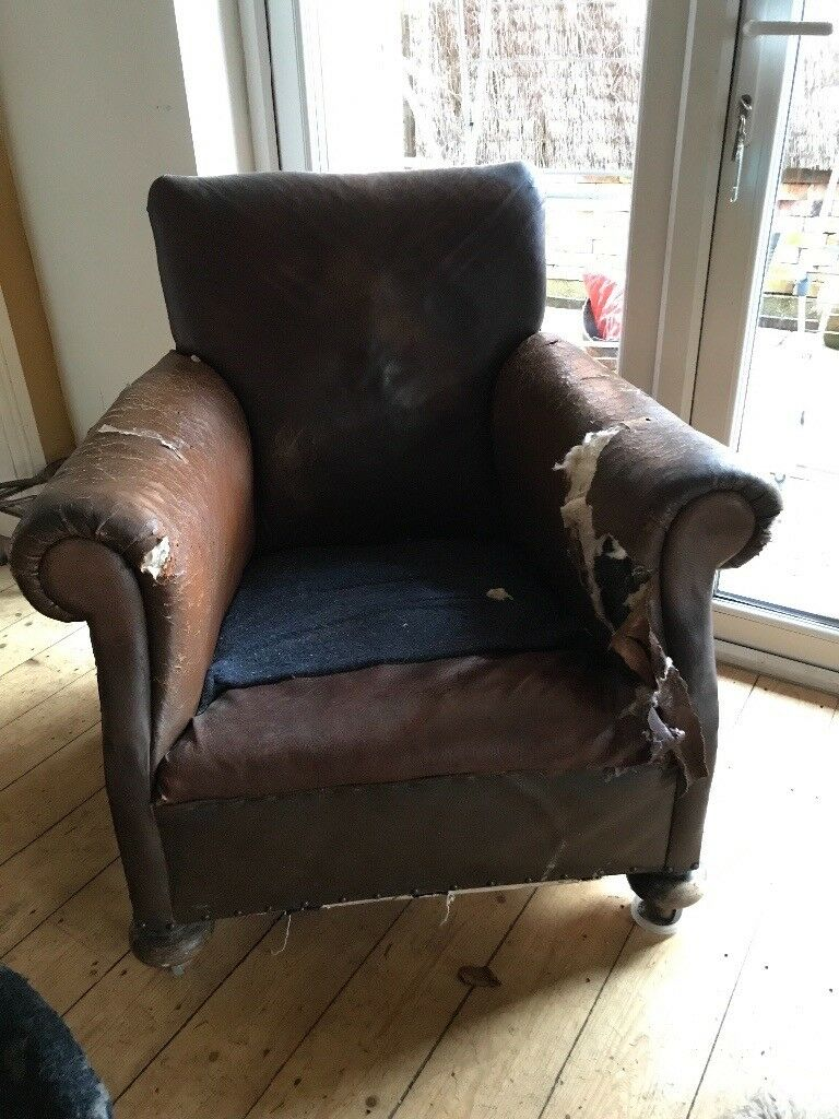 Old leather chair. Perfect restoration project for someone