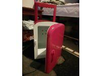 Small pink mini fridge